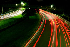 Speed of Light. Car lights on highway at night Stock Photos
