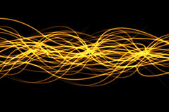 Speed of light. Yellow lines on a black background Royalty Free Stock Photos