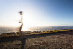 Speed of light. A runner running in the morning after sunrise Royalty Free Stock Photos