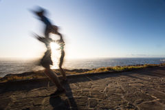 Speed of light. Two runners running in the morning after sunrise Royalty Free Stock Image