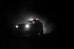 Speed lighting of police car in the night on the road. Police cars on road moving with fog. Selective focus. Chase. Speed lighting of police car in the night on stock photography