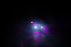 Speed lighting of police car in the night on the road. Police cars on road moving with fog. Selective focus. Chase. Speed lighting of police car in the night on royalty free stock images