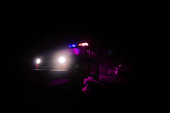 Speed lighting of police car in the night on the road. Police cars on road moving with fog. Selective focus. Chase. Speed lighting of police car in the night on royalty free stock photo