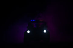 Speed lighting of police car in the night on the road. Police cars on road moving with fog. Selective focus. Chase. Speed lighting of police car in the night on royalty free stock photos