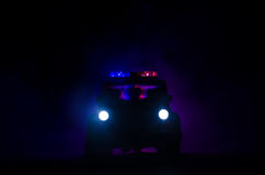 Speed lighting of police car in the night on the road. Police cars on road moving with fog. Selective focus. Chase. Speed lighting of police car in the night on royalty free stock image
