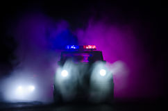 Speed lighting of police car in the night on the road. Police cars on road moving with fog. Selective focus. Chase. Speed lighting of police car in the night on stock image