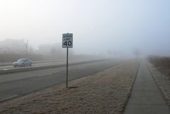 Speed limit. Foggy morning. For safety reason speed limit 40 mph stock photography