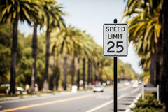 Speed Limit 25 sign. On the road with palms, USA Stock Images