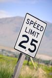 Speed limit. Posted speed limit sign on side of road Royalty Free Stock Images