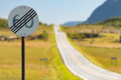 60 speed limit cancel road sign in Norway. Road travel by car in Scandinavia stock photography