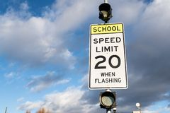Speed limit 20 when flashing sign near school. royalty free stock photography
