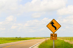 Speed Limit in the Flint Hills. Road sign displaying the maximum speed of 50 mph and that it is a curvy road in the Flint Hills region in Kansas Stock Image