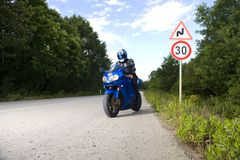 Speed limit and the motorbike Royalty Free Stock Photography