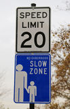 Speed limit 20 and Neighborhood Slow Zone signs. Neighborhood Slow Zones are a community-based program that reduces speed limit Stock Image