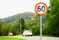 60 speed limit road sign background Stock Photo