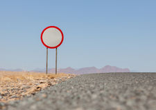 Speed limit sign at a desert road Stock Photos