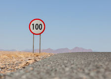 Speed limit sign at a desert road in Namibia Royalty Free Stock Images