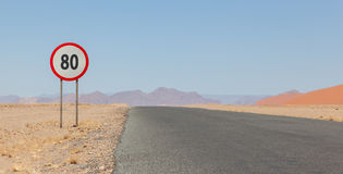 Speed limit sign at a desert road in Namibia Stock Photo