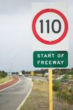 Speed limit sign on highway Royalty Free Stock Photos