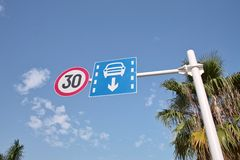 Speed Limit Sign and Lane. The road signs are a view of a road Royalty Free Stock Image