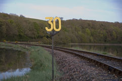 Speed limit sign on railway Stock Photography