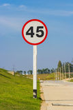 Speed limit sign on road Royalty Free Stock Photos