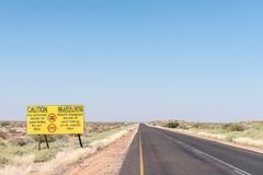 Speed limit sign on road R360 between Askham and Upington. A speed limit warning sign on the R360-road between Askham and Upington in the Northern Cape Province royalty free stock images