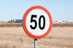 Speed Limit Sign in Rural Setting Stock Photo