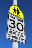 Speed Limit Sign in School Zone Stock Images
