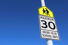 Speed Limit Sign in School Zone Stock Photos