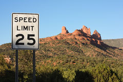 Speed limit sign in Sedona, Arizona. 25 MPH speed limit sign in Sedona, Arizona with red sandstone stock photo