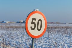 Speed limit sign 50. During winter Royalty Free Stock Photo