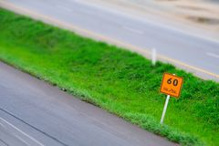 Speed limit sign with a traffic in the background. royalty free stock image