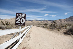Speed limit sign. Twenty mph speed limit sign on empty valley road Royalty Free Stock Images