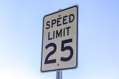 Speed limit sign viewed with a sky background stock photos