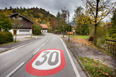 Speed limit sign in the village Royalty Free Stock Photography
