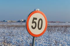 Speed limit sign 50. During winter Royalty Free Stock Photography