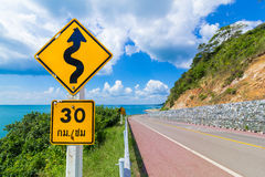 Speed limit signs of 30 km / hour and beware meander sign Royalty Free Stock Images