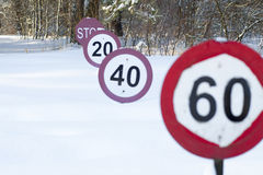 Speed limit signs under the snow Royalty Free Stock Photo