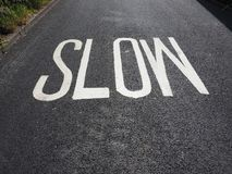 Slow sign on street. Speed limit slow sign on a street stock photography