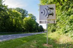 Speed limit speed camera sign close to the road Stock Images
