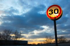 Speed limit at sunset. stock images
