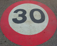Speed limit thirty. Times to protect cyclists royalty free stock photo