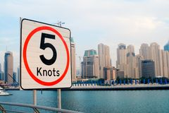 Speed Limits for Yachts - Dubai Marina. Speed limit sign for yachts and boats at one of the Dubai Marina entry points... Maximum speed of 5 knots Stock Image