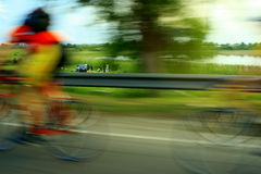 Speed maniacs. On bicycle Royalty Free Stock Photos