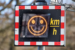 Speed monitoring with smiley. On the display Royalty Free Stock Image
