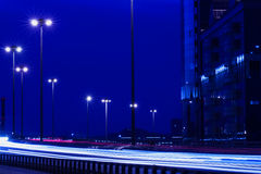 Speed motion with blue light trails , modern city Royalty Free Stock Photos