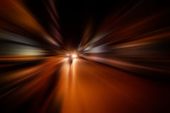 Speed motion blur on road at night Stock Photography