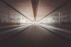 Speed motion blur on transportation, blue light in perspective line. Concept of the movement path. Moving waklway in the airport terminal, travel concept royalty free stock photography