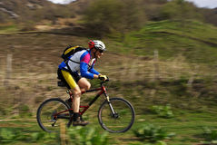 Speed motion mountain biker Royalty Free Stock Photography